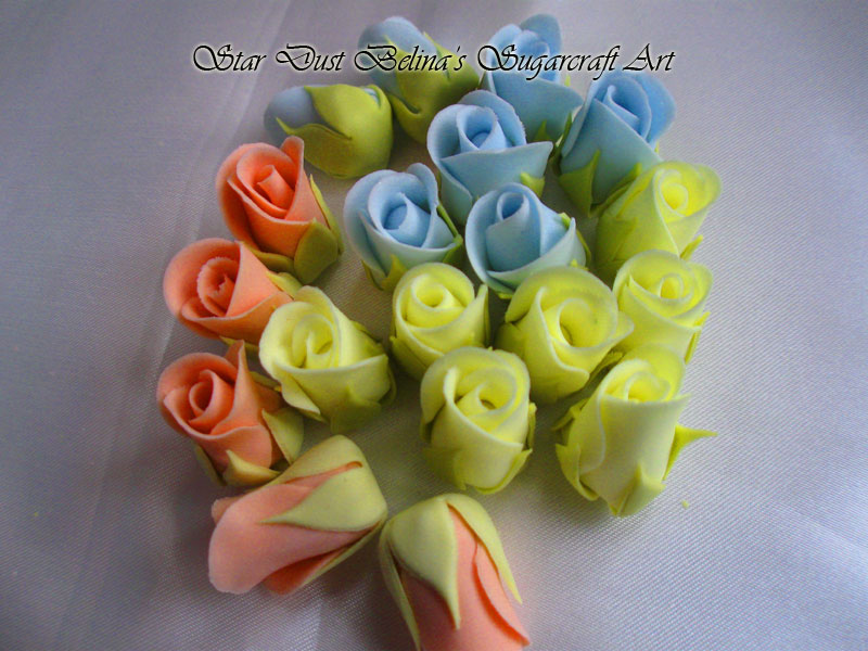 Yellow,Orange and Blue roses buds