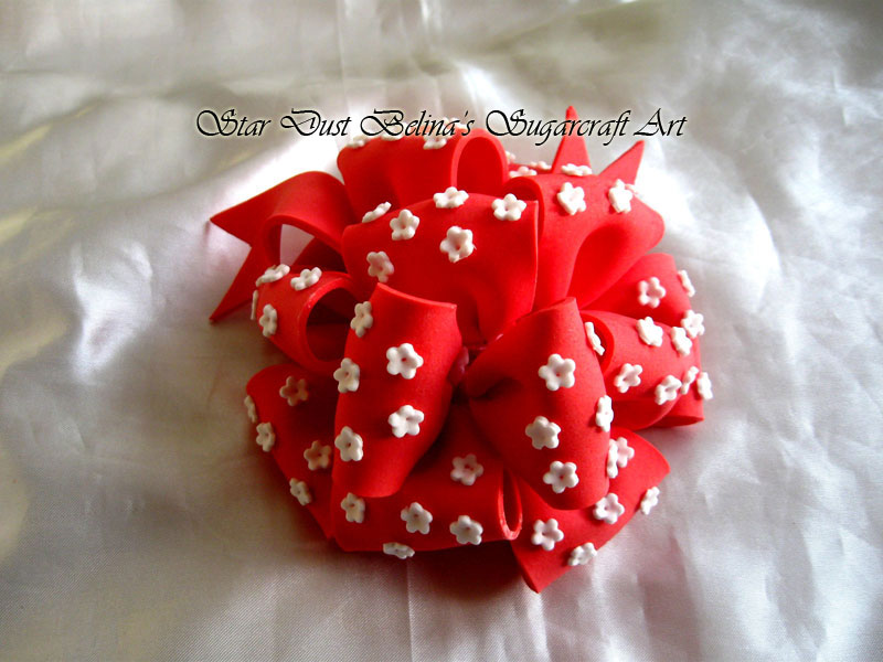 Handcrafted Elegan Bow in Poppy Red with White Blossoms