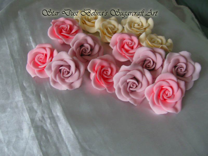Pastel coloured medium roses sugar flowers
