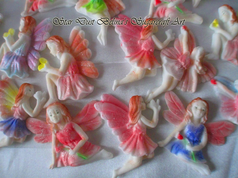 Rainbow colored sugar fairies